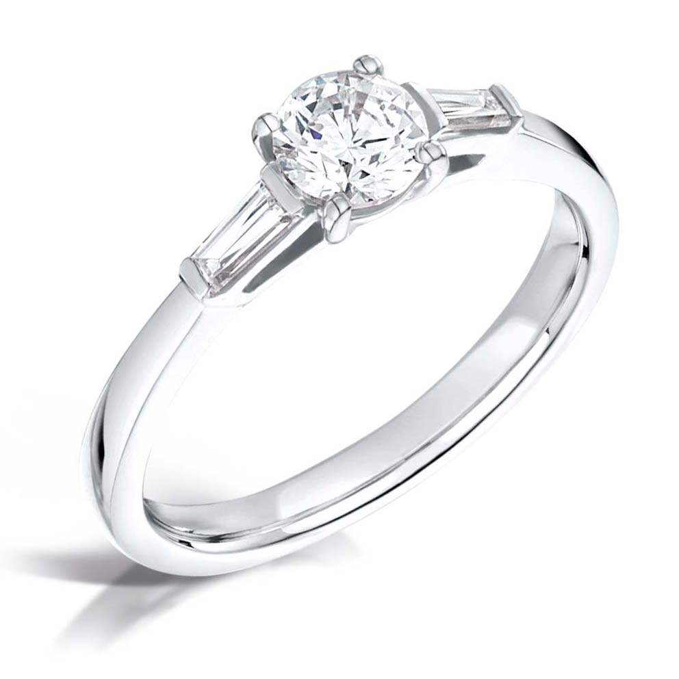 round-diamond-with-tapered-baguette-diamonds-platinum-trilogy-engagement-rings.jpg